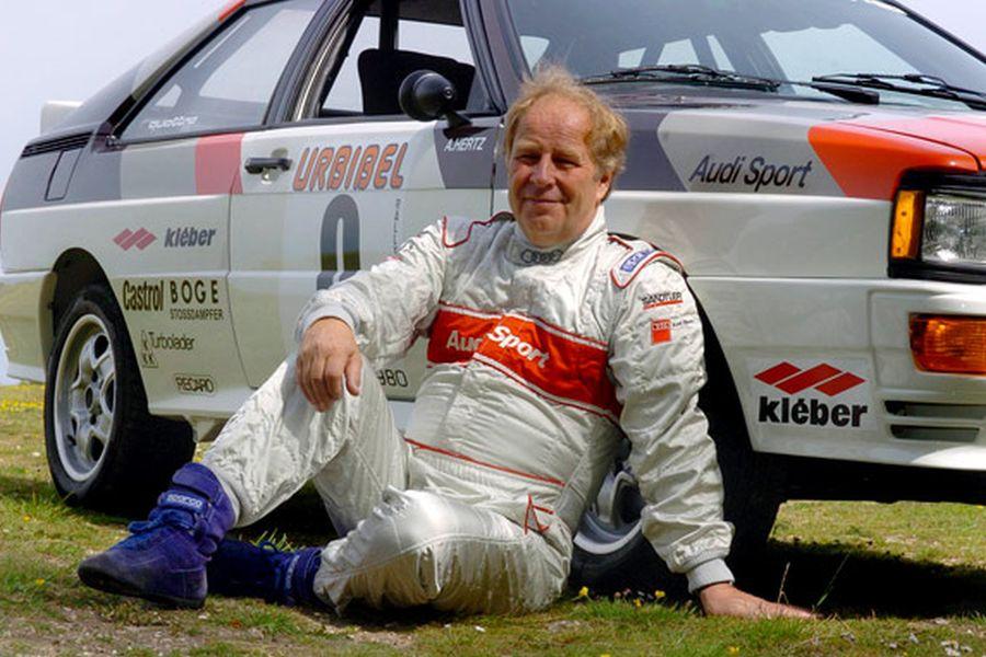 Hannu Mikkola next to his Audi Quattro