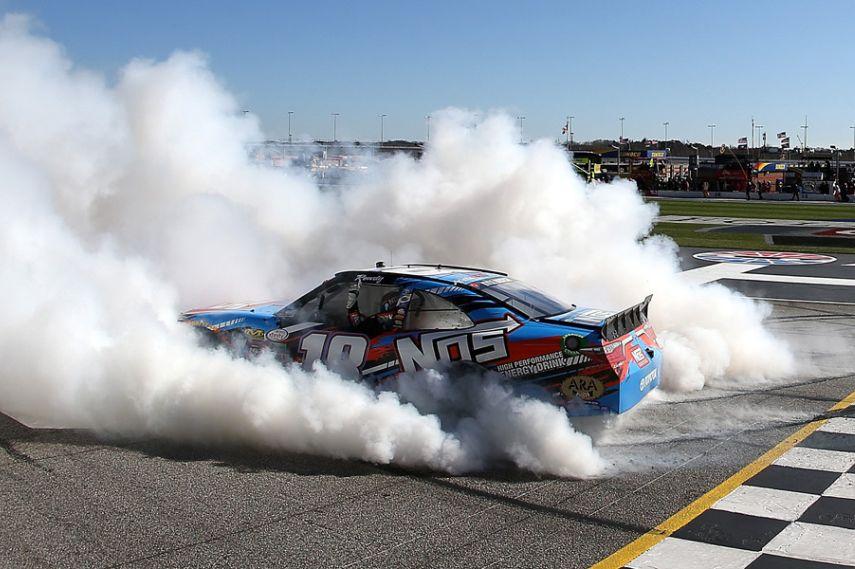 Kyle Busch celebrating victory in NASCAR Xfinity Series race at Atlanta Motor Speedway