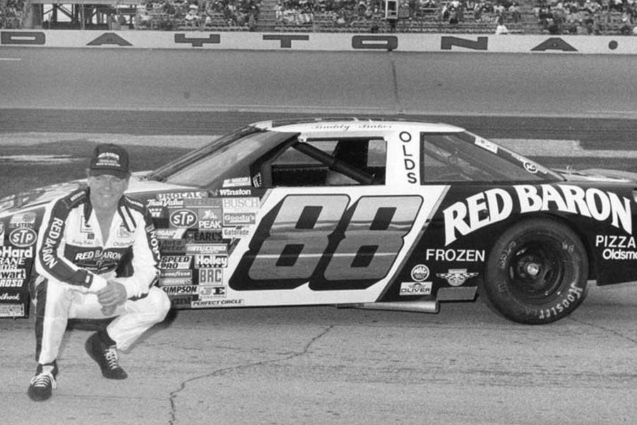 Buddy Baker posing next to his #88 Oldsmobile