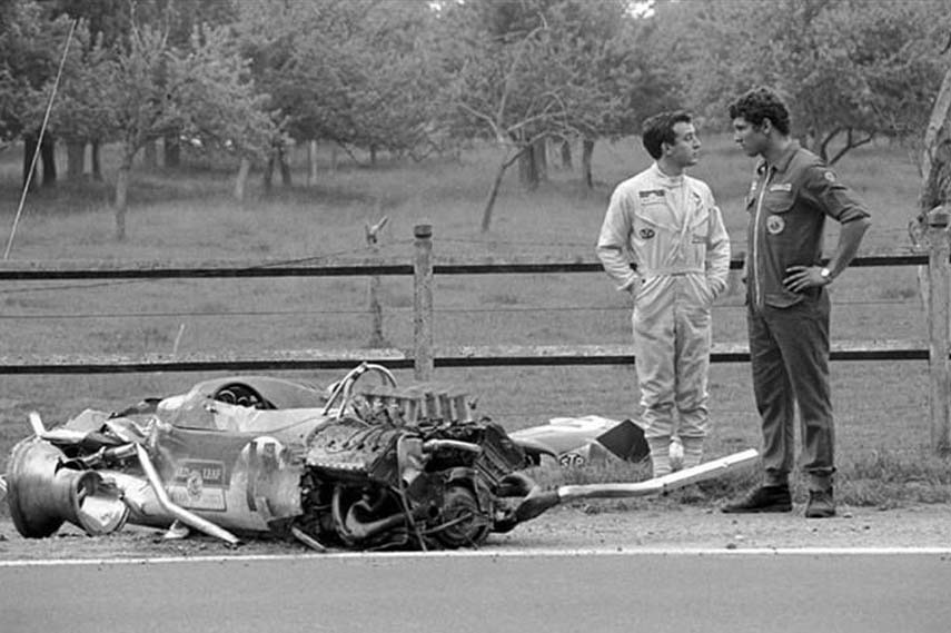 Jackie Oliver and a wrecked Lotus 49