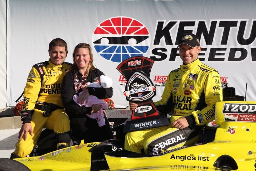 Andy O'Gara, Sarah Fisher, daugher Zoey and Ed Carpenter after team's first victory in 2011