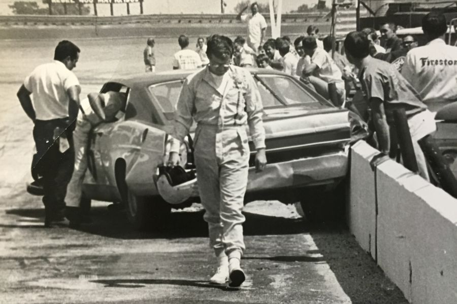 Driver walking away from the crash, Darlington Raceway, black and white