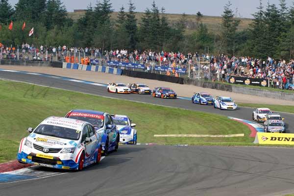 BTCC racing at Knockhill Racing circuit