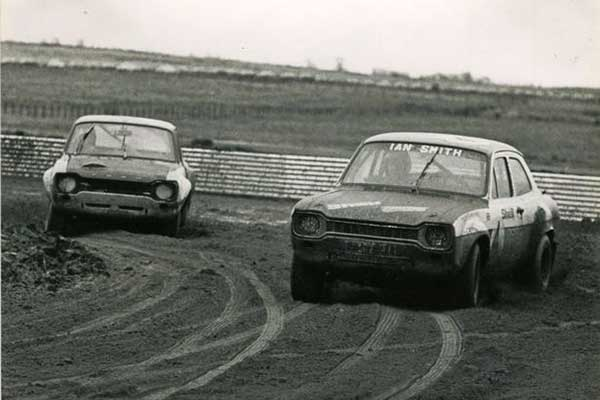 Cars racing through the mud in Knockhill, black and white