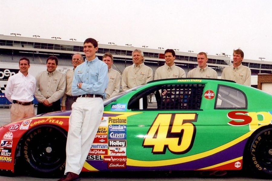 Adam Petty next to his 1999 Busch Series race car, the #45 Chevrolet