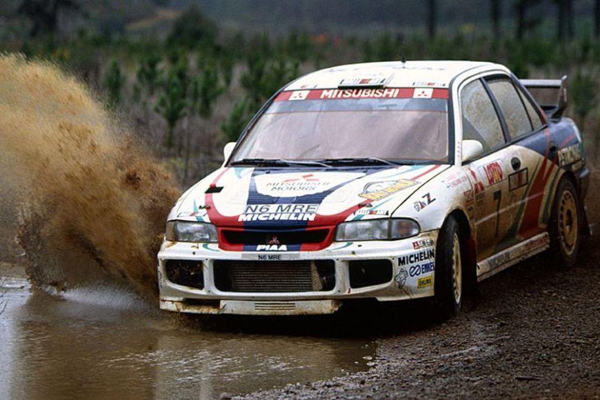 Mitsubishi Lancer Evo III racing through mud, 1996