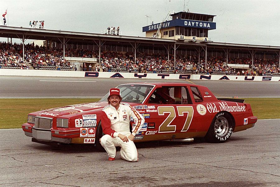 Tim Richmond next to his #27 Old Milwaukee Pontiac