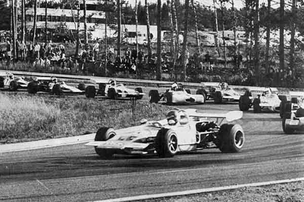 Ronnie Peterson racing at Mantorp park, black and white