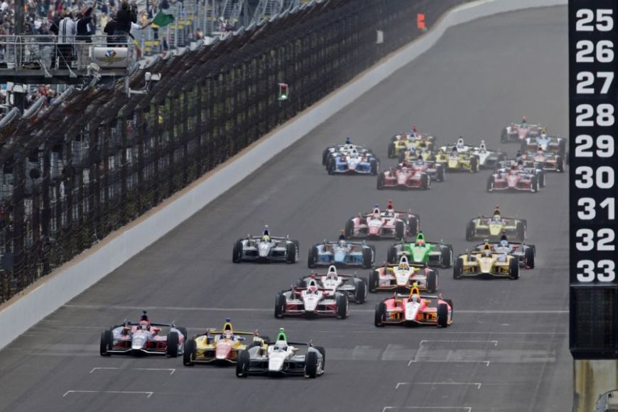 Ed Carpenter leads the field as the cross the start/finish line on the start of the Indianapolis 500 auto race at the Indianapolis Motor Speedway in Indianapolis Sunday, May 26, 2013.