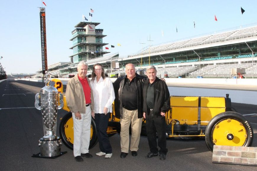 Rick Mears, Mari Hulman George, A.J. Foyt and Al Unser Sr with the trophy