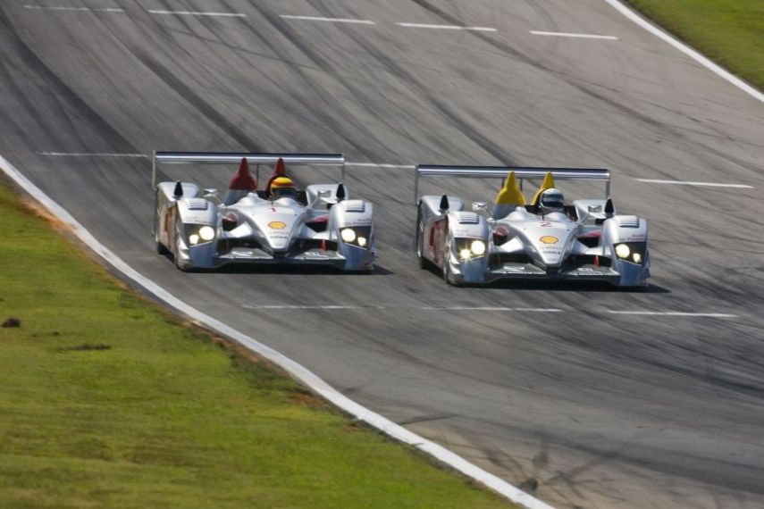 Two Audi R10 TDI racing side by side