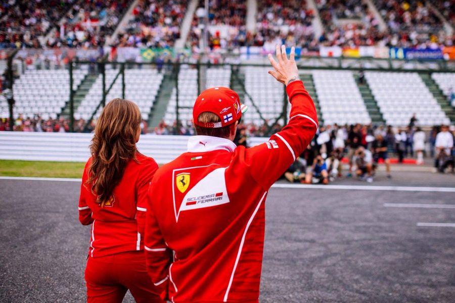 Kimi Raikkonen waving to fans