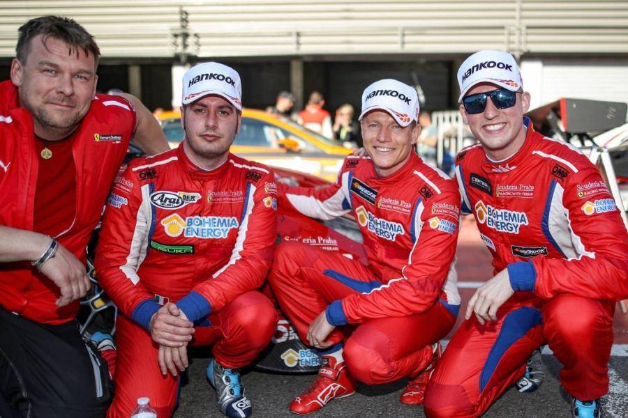 Victorious crew of the #11 Ferrari 488 GT3