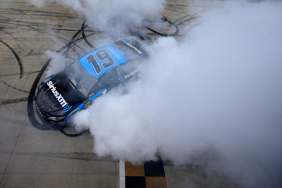 Martin Truex celebrates victory at the Monster Mile