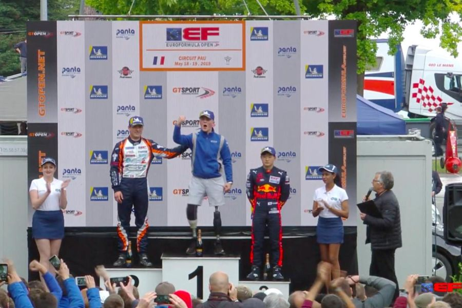 Billy Monger on the top of the podium