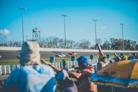 People Cheering at a Nascar Race