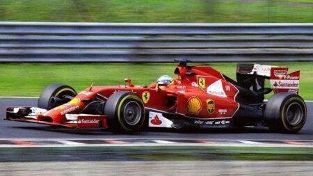 A Red Ferrari F1 Car Racing