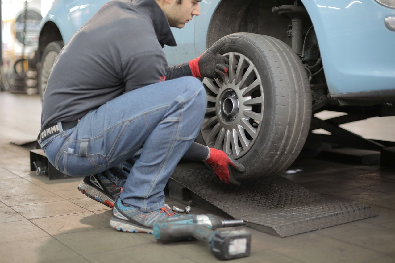 Mechanic Replacing A Tyre